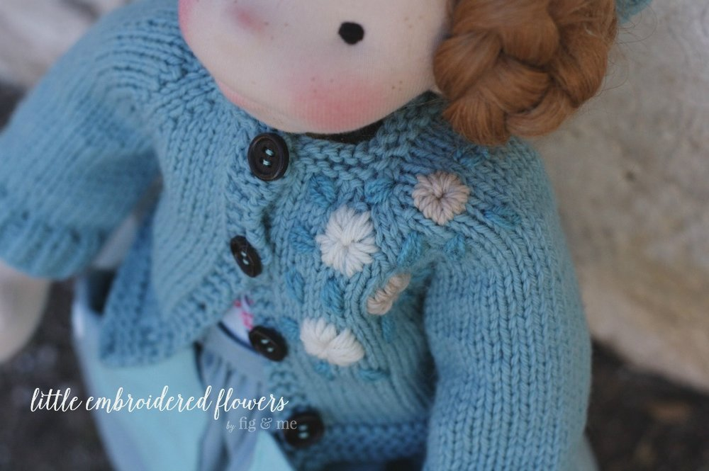 Little wool embroidery flowers on her cardigan. Waldorf-inspired doll clothing by Fig and Me.
