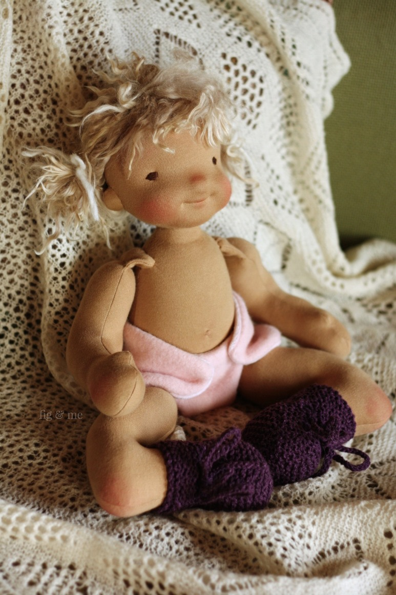 Ida May in her wooly diaper and knitted boots. By Fig and Me.
