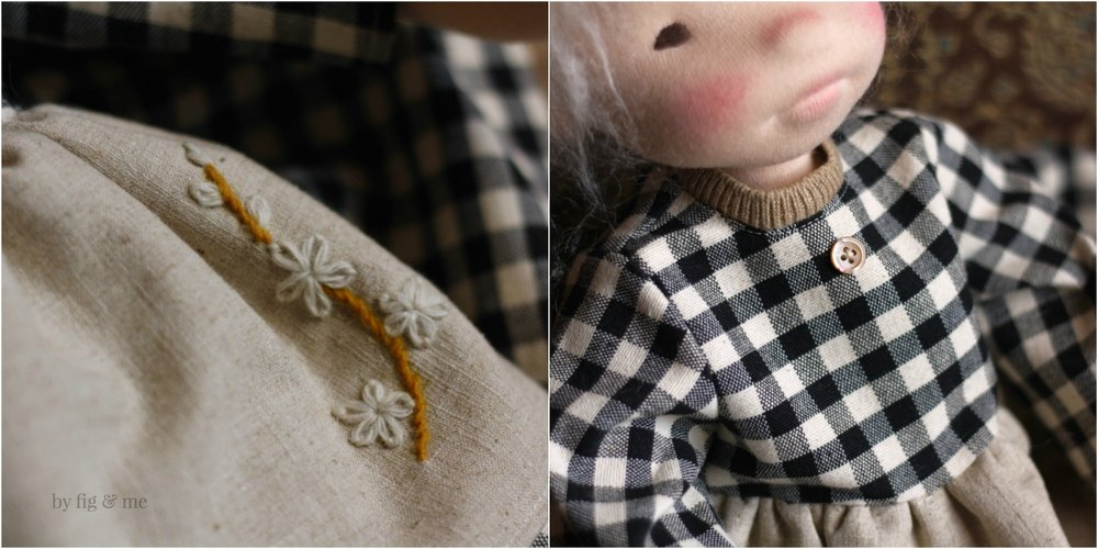 Little details of Raisa's meadow dress: wool stitch flowers on her lined linen apron, a wee button and some cashmere ribbing. By Fig and Me.