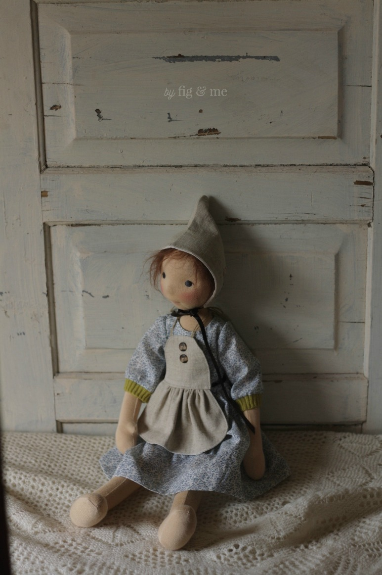 Poet wearing a linen bib apron and a Fig bonnet, by Fig and Me.