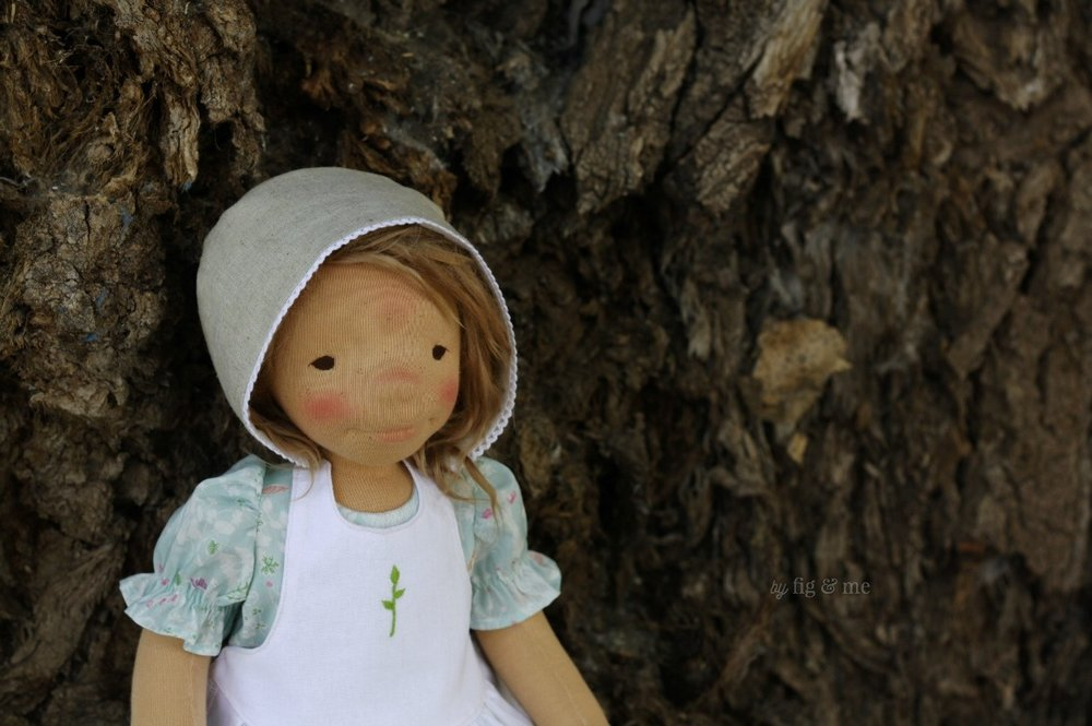 Little Ada, a natural cloth art doll by Fig and Me. Made with swiss jersey, and stuffed ever so firmly with wool. Hair made of alpaca locks and clothes of natural fibers.