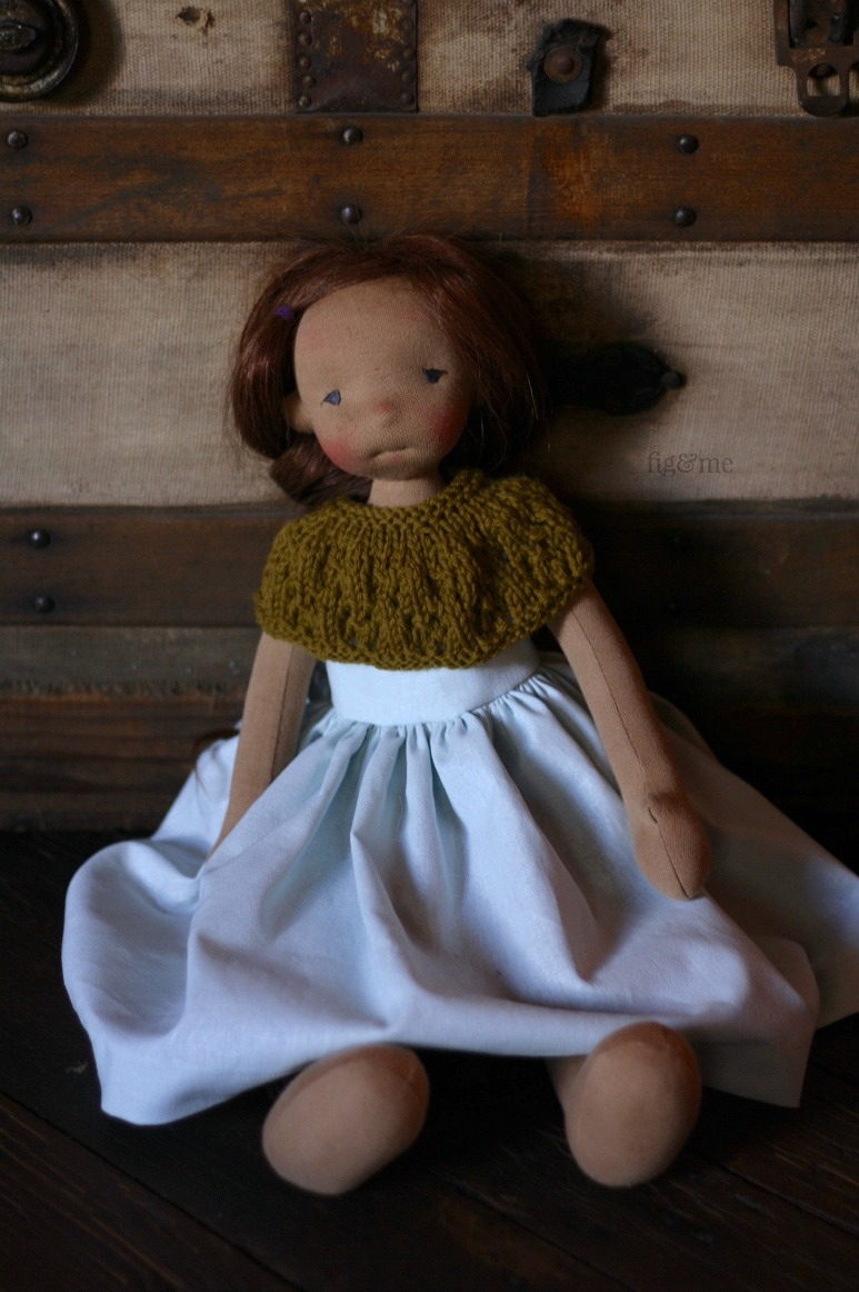 Asia, a natural fiber art doll by Fig and Me. Wearing a long linen dress, and a wool shawl.