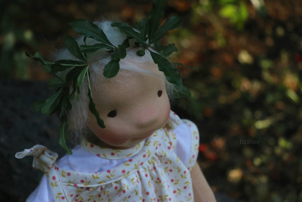 Romy with her crown of pomegranate leaves, by Fig and Me.