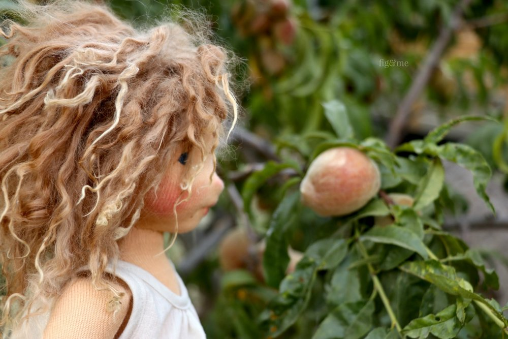 Miss Anne, staring at the peaches. A custom made, natural fiber art doll by Fig and Me.