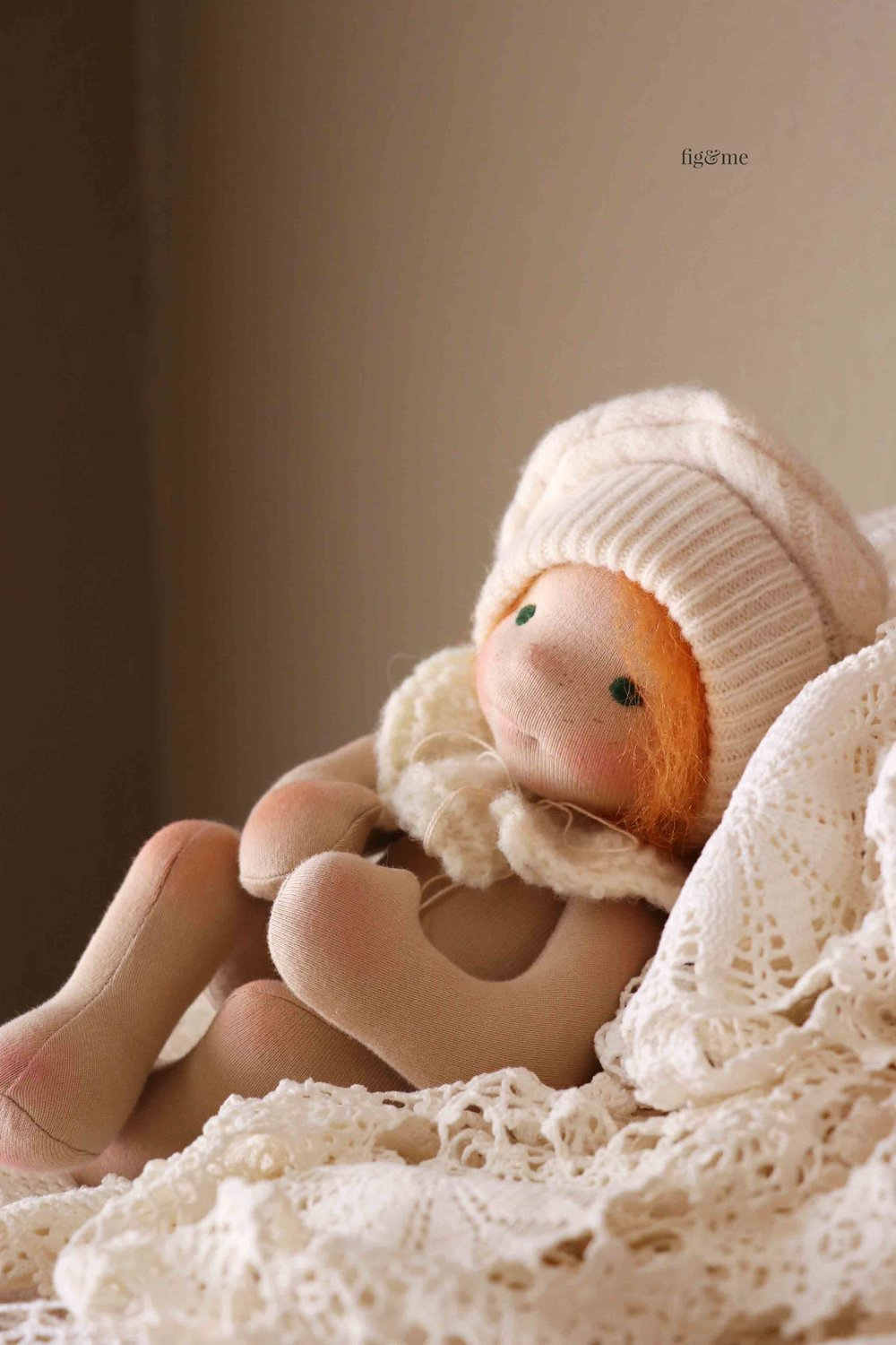 """A wee 11"""" tall natural fiber art baby doll by Fig and Me. Basking in the light."""