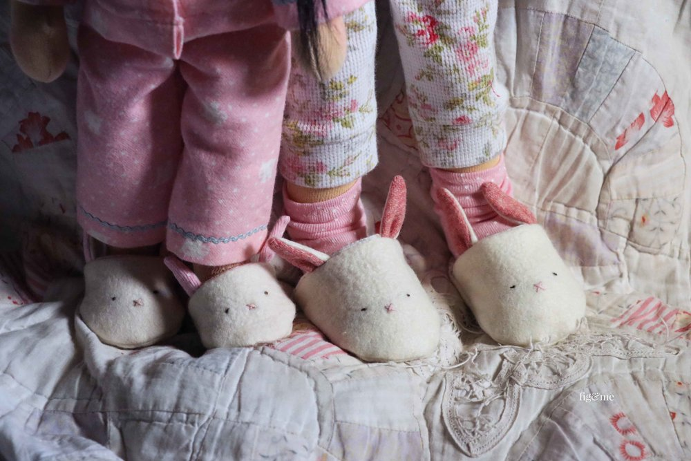 The dolls in their matching wool felt bunny slippers. by Fig and Me.