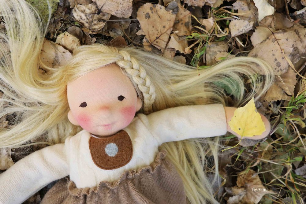 Aspen playing outside, a natural fiber art doll by Fig and Me. #dollmaking #waldorfinspired #clothdoll