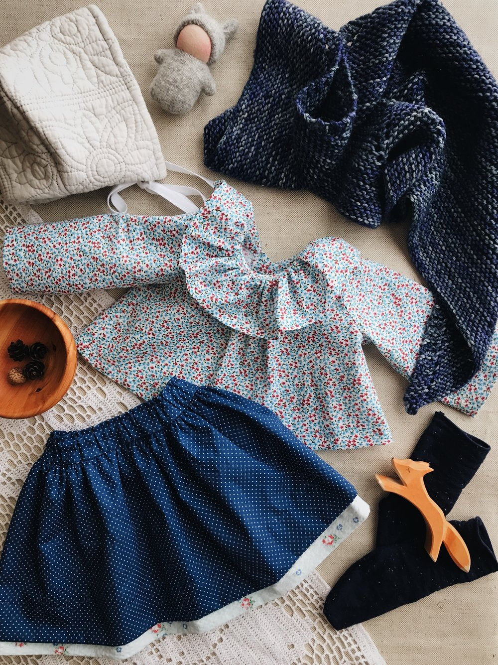 Thora's clothing, minus her shoes. Thora is a sweet doll that will become available for sale this weekend. via Fig and Me. #dollclothing #sewingdollclothes #madelinetosh