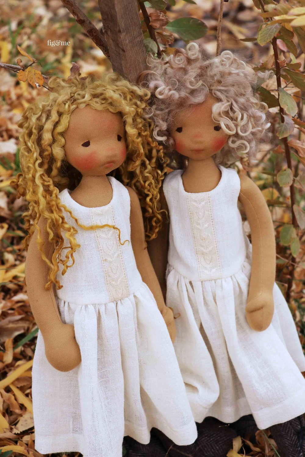 Mori, the blonde, and Winter, with the short hair. Two natural fiber art dolls by fig and me.
