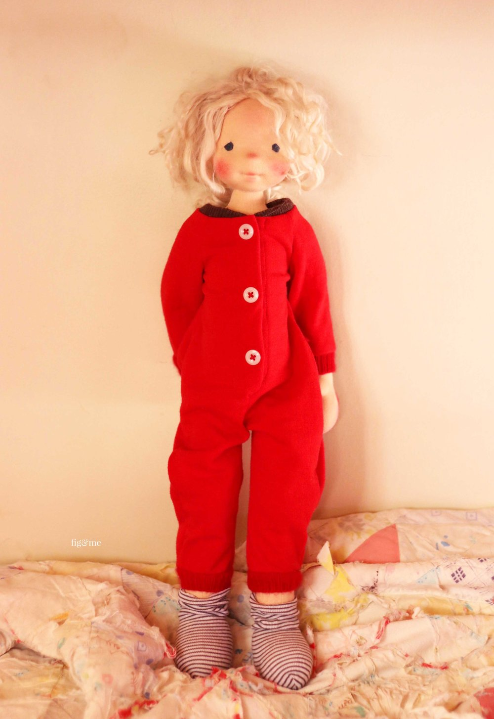"""Runa is a natural fiber art doll, of the 18"""" tall variety, wearing her Christmas pajamas. Doll made by Fig and Me."""