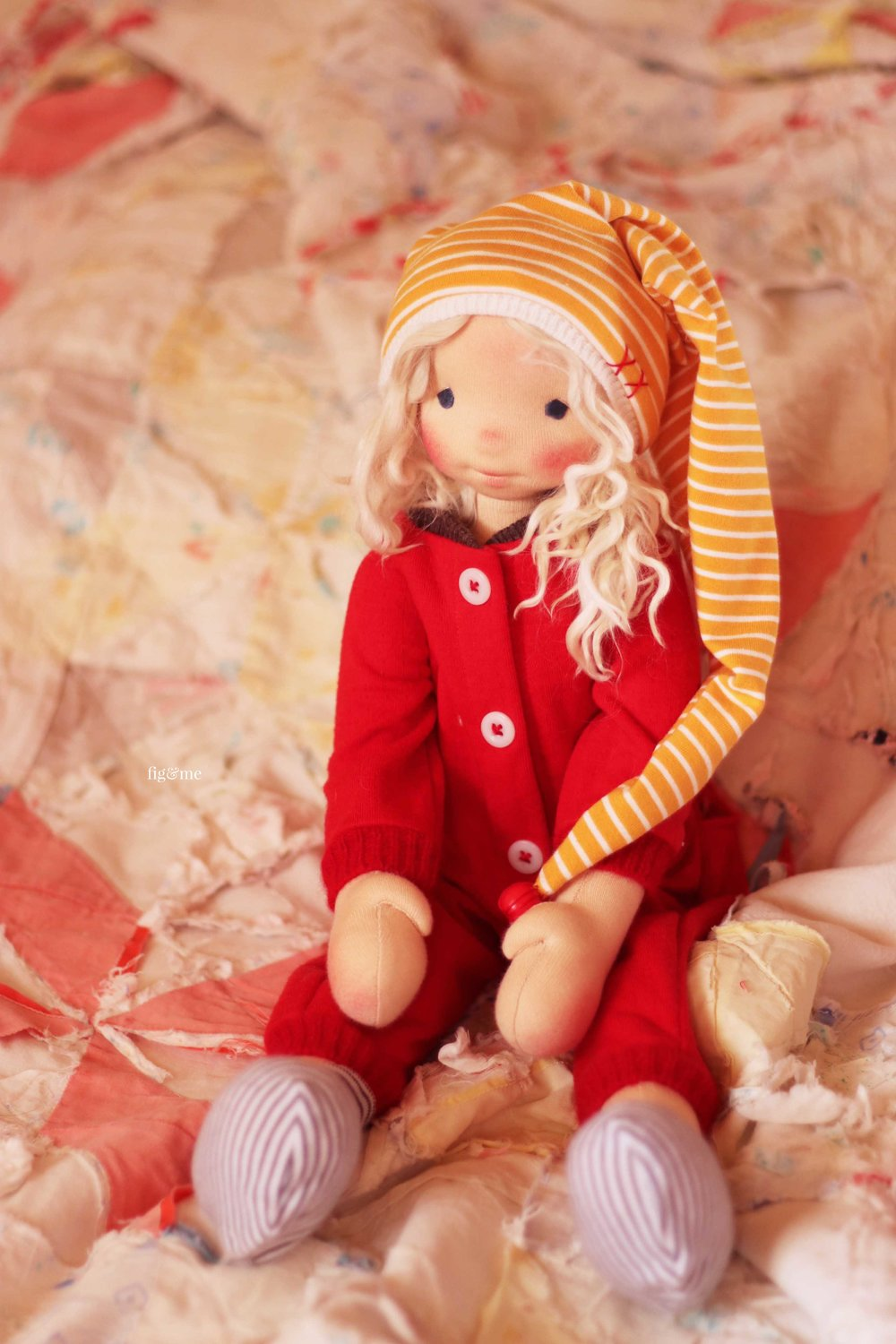 Runa, envisioning all the baking she wants to do. A natural fiber art doll by Fig and me.