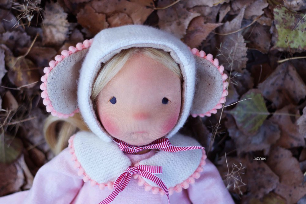 Little Amber, a natural fiber art doll by Fig and Me. Wearing her Mouseling Hat and matching collar.