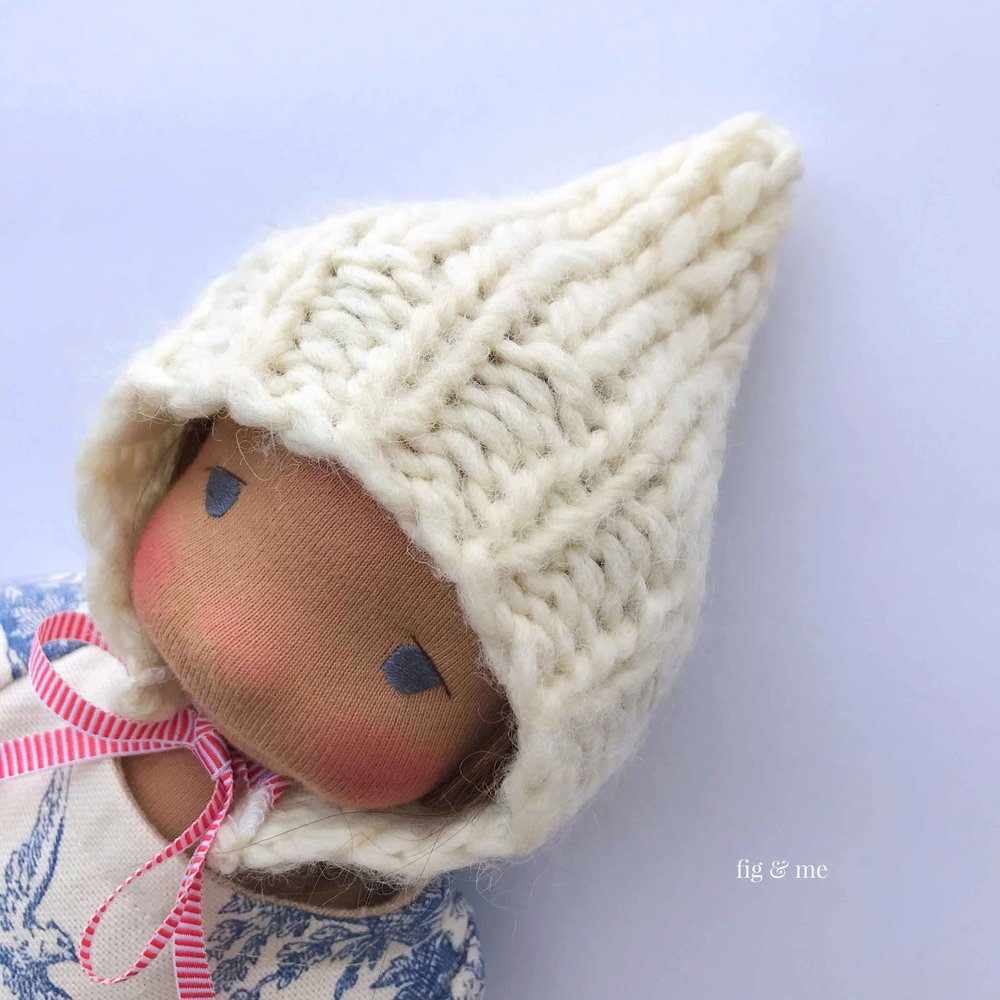 A tutorial for sewing a doll's hat with repurposed knit. via Fig and Me. #dollmaking