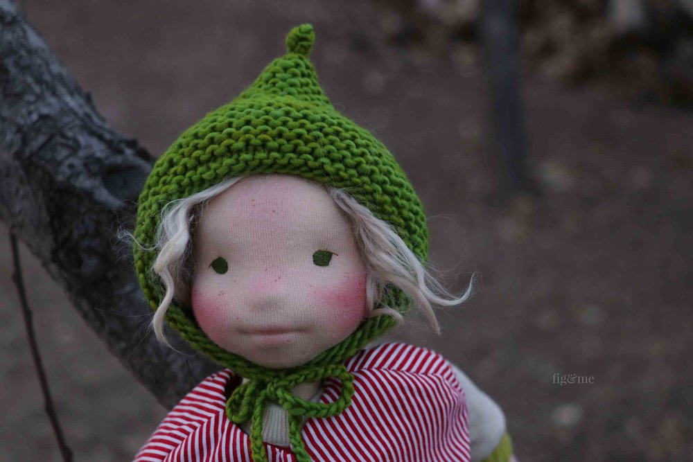Snow White is a natural fiber art doll by Fig and Me. Wearing her knitted Le Fig hat.