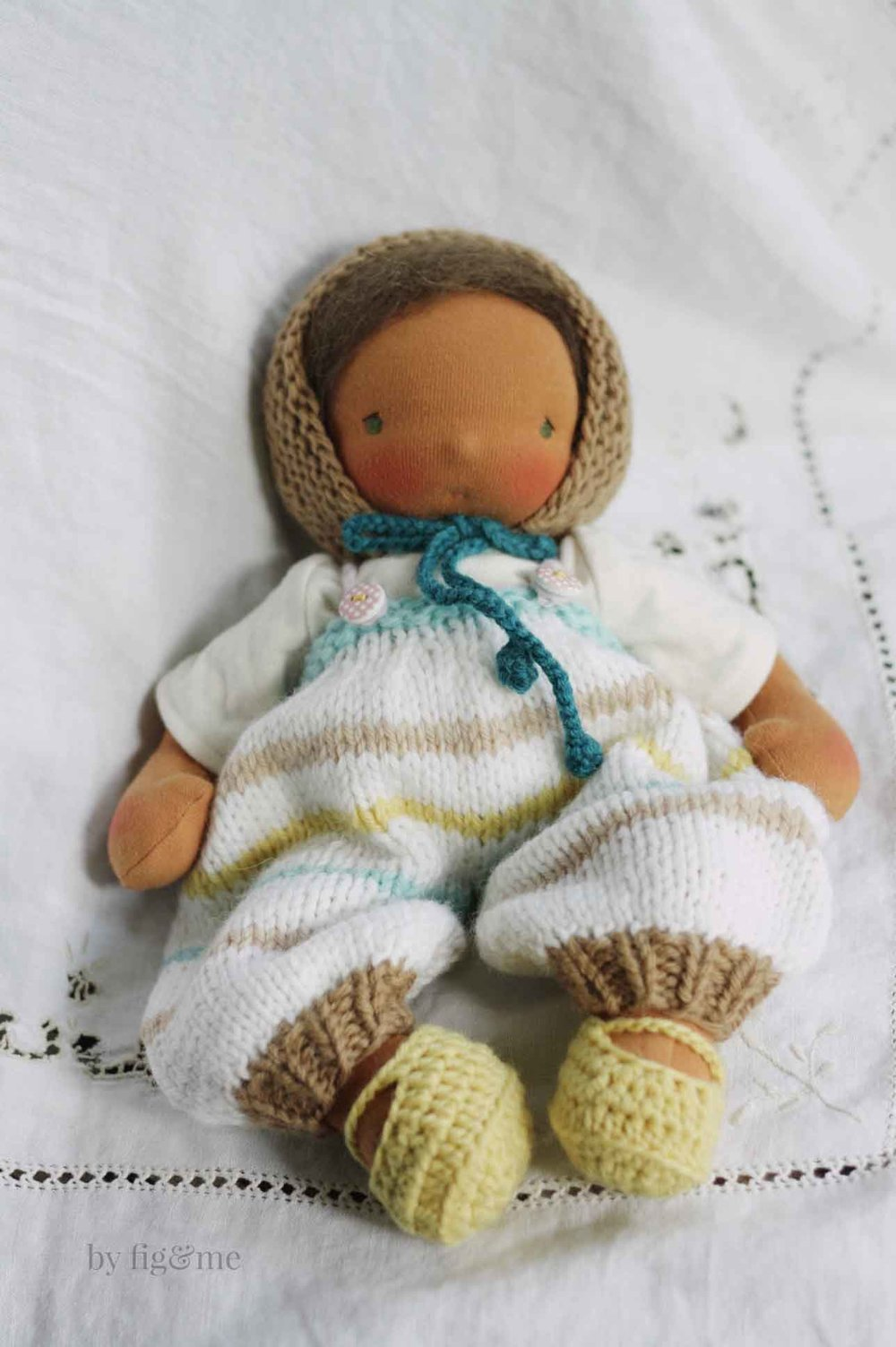 Balloon knitted overalls for your baby doll. Knitting pattern available from Fig and Me.