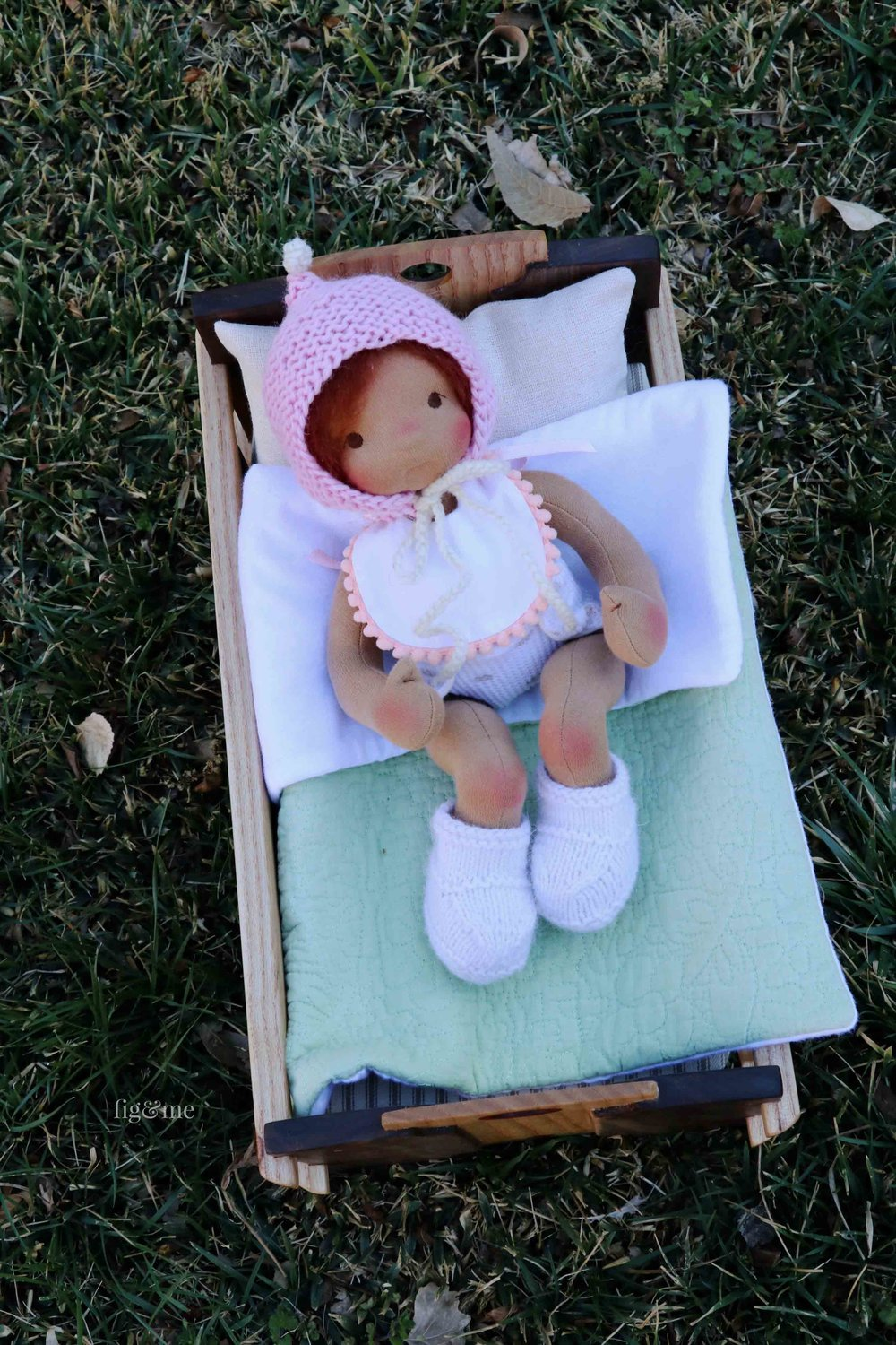 Baby doll Kasja in her wooden cradle, by Fig and Me.