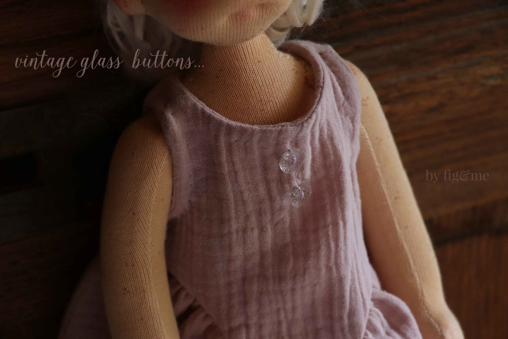 Vintage glass buttons on Anwen's new doll dress, by Fig and me.
