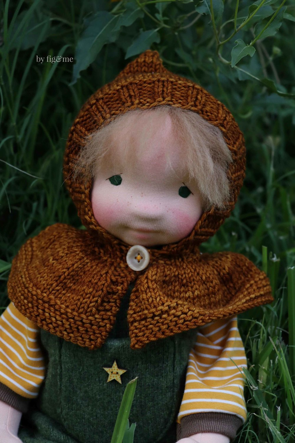 Wulfric, wearing his knitted hooded capelet. Natural art doll by Fig and Me.