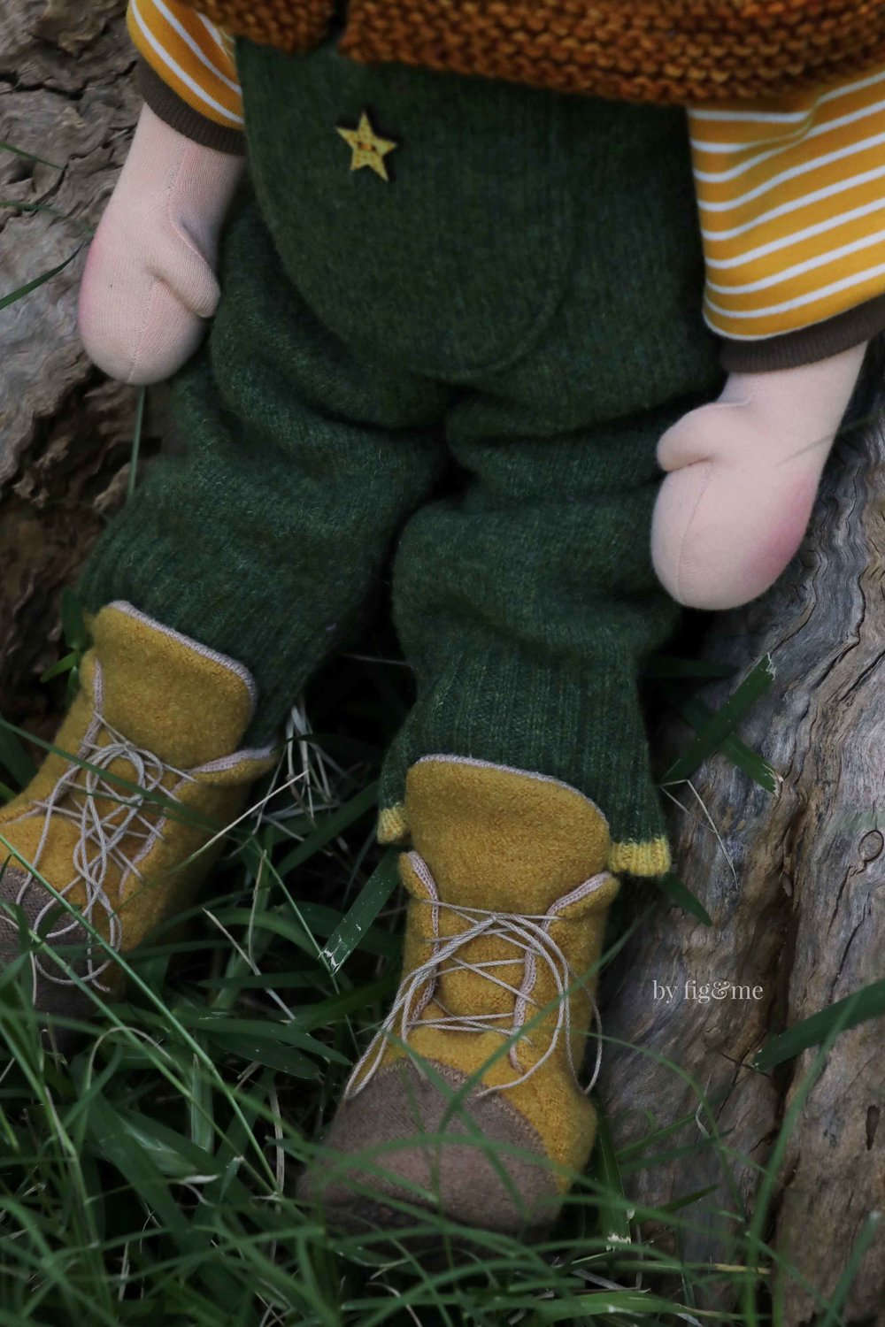 Wulfric wears tall boots, made with felted italian merino and lined with jersey. His lambswool overalls and his organic tshirt.