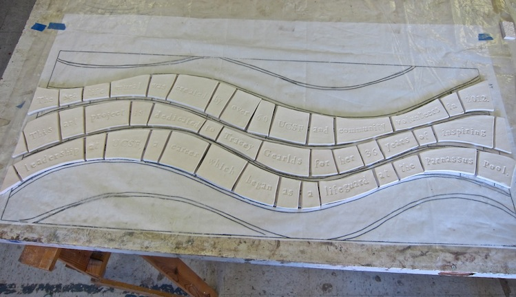 Out of the kiln, ceramic tiles are ready to be glazed.