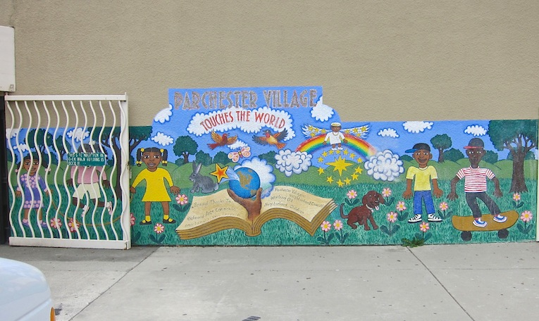 Existing mural on the front of the community center. Artist unknown