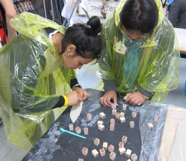 Participants making tiles