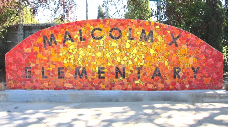 Malcolm X Elementary sign, community project, 15'w x 5'h