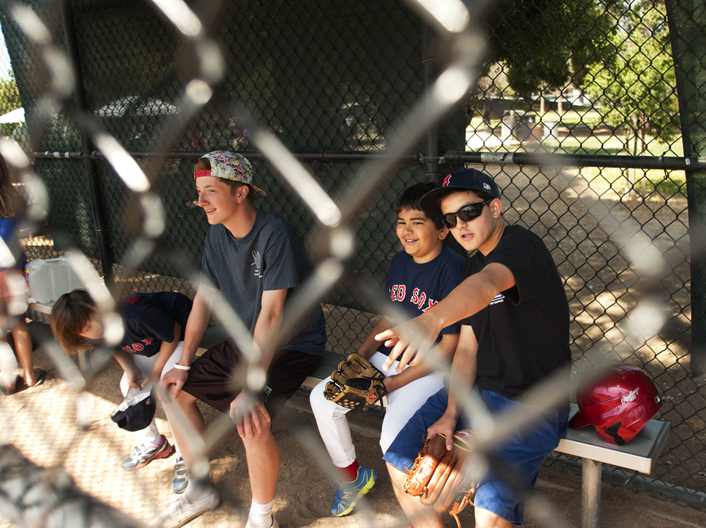 Morgan Serughetti, right, jokes with his buddy Sam, center right, about which of the two is better at baseball during the Little League Challenger game in Menlo Park, Calif. on April 19, 2015.