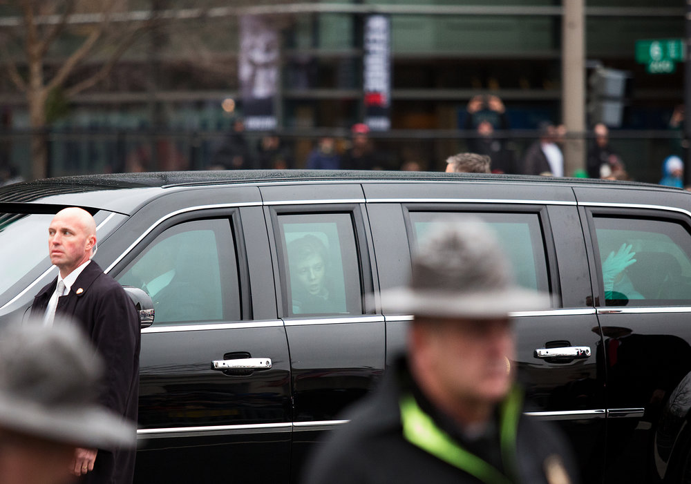 Barron Trump peeks out at the crowd watching the President Donal Trump's Inaugural Parade on January 20, 2017.