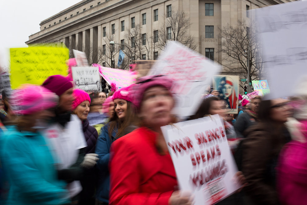 A girl turns to speak to a friend during the 2017 Women's March along Pennsylvania Avenue in Washington D.C. on January 21, 2017.