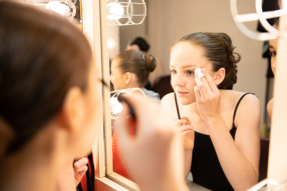 "Polina Bortok applies her makeup backstage before Western Ballet's production of ""The Nutcracker"" at the Mountain View Center for the Performing Arts on Dec. 2, 2018."