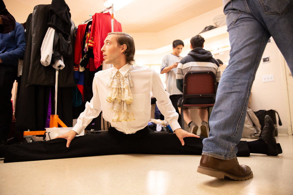 "Joe LaChance, who plays the Snow King, stretches in the men's dressing room backstage before Western Ballet's production of ""The Nutcracker"" at the Mountain View Center for the Performing Arts on Dec. 2, 2018."