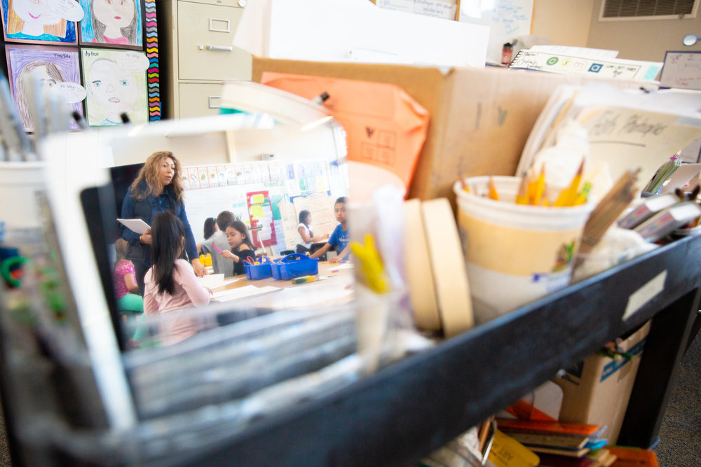 Art teacher Cristina Velazquez looks over her students' work at Gabriela Mistral Elementary School in Mountain View, California, on Dec. 6, 2018.