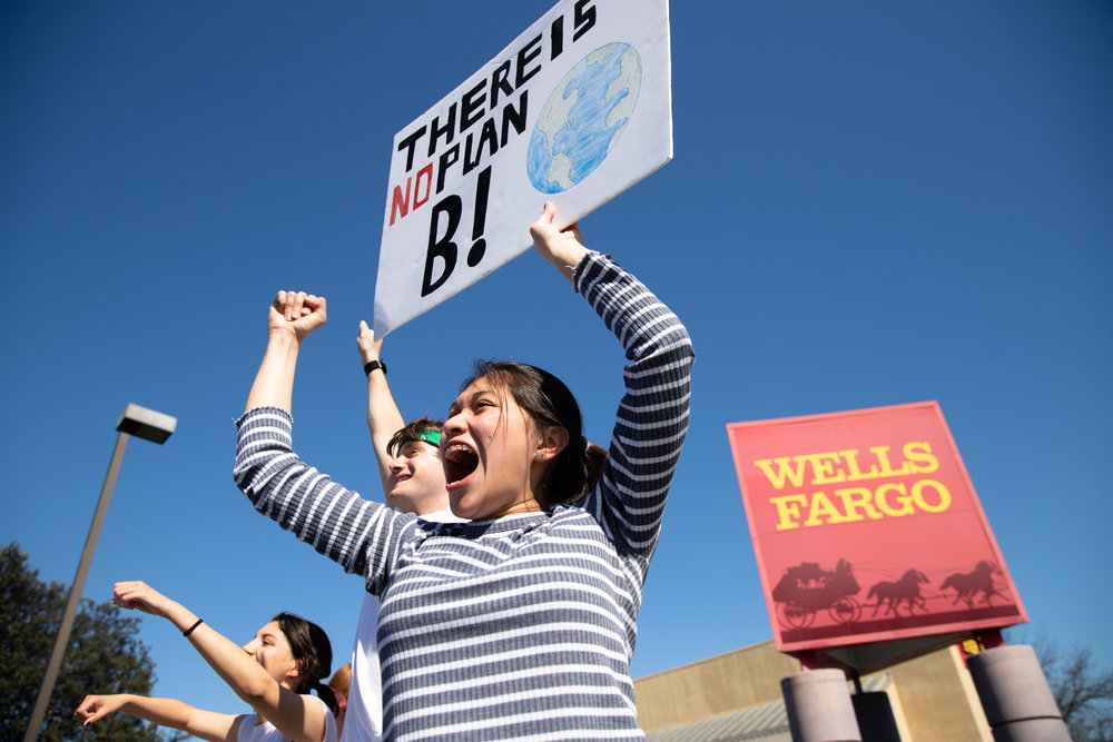 Montserrat Mendez, a Los Altos High School juniors, cheers during a protest against government inaction on addressing climate change at the intersection of El Camino Real and San Antonio Road in Mountain View, California, on March 15, 2019. Photo by Magali Gauthier
