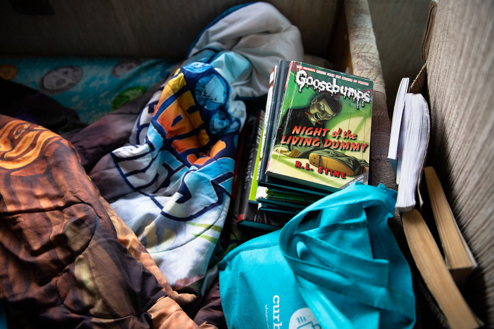 Scott Rodvold's son's books on his bed in the family's motorhome along Continental Circle in Mountain View, California, on March 8.