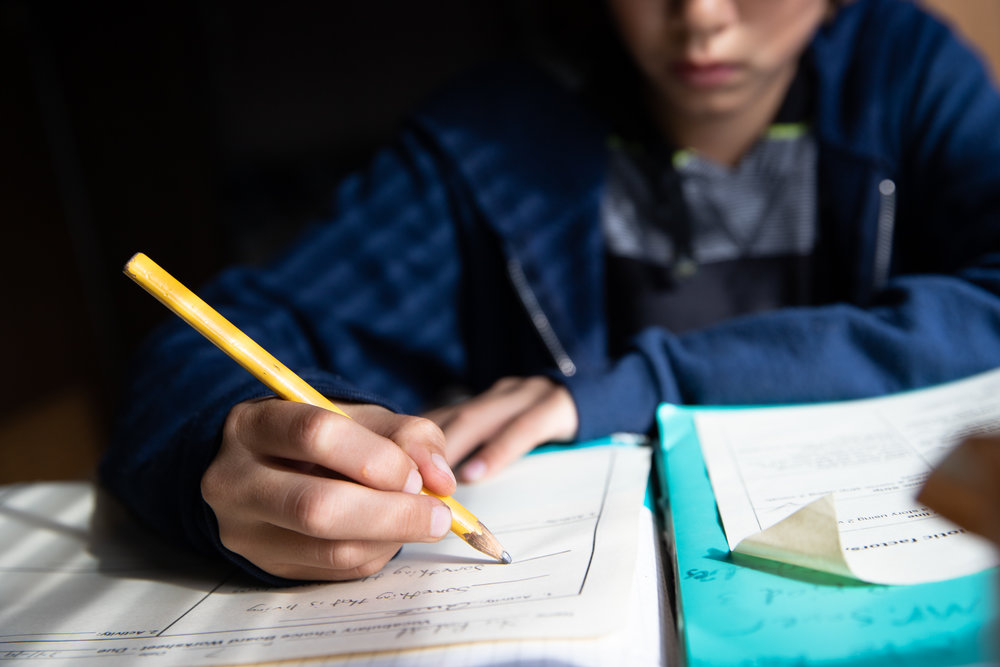 Scott Rodvold's son works on his science homework on a Friday afternoon in the family's motorhome along Continental Circle in Mountain View, California, on March 8.