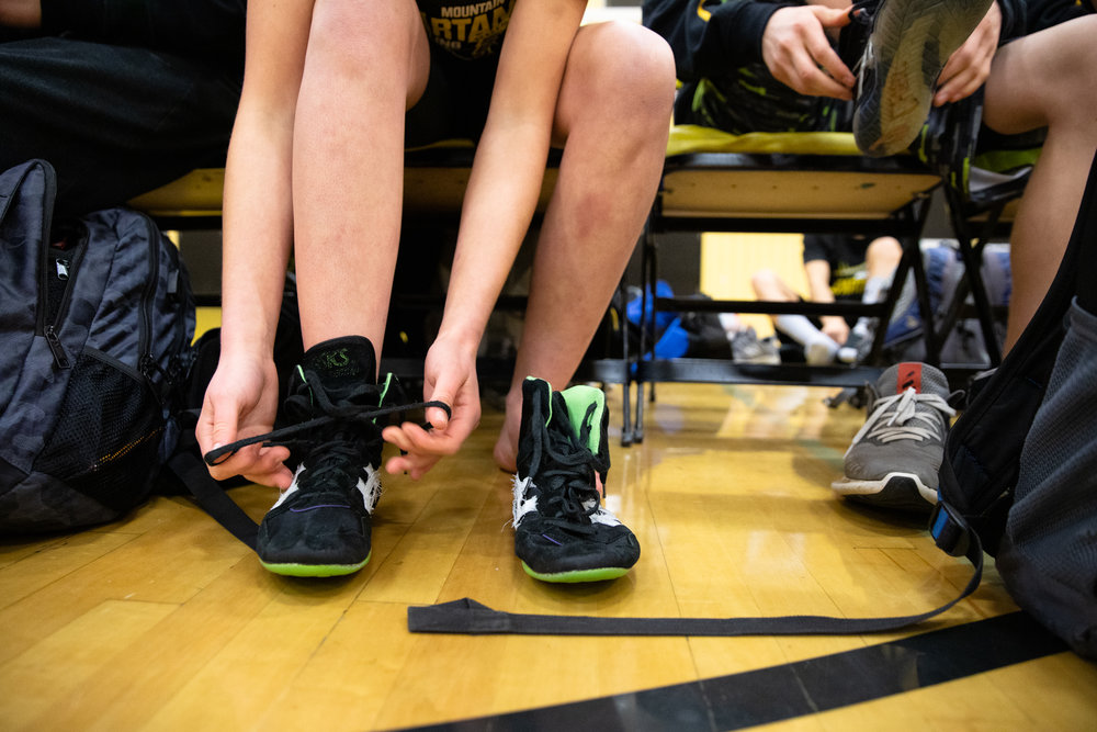 Paris Harrell puts on her shoes before a home meet against Homestead High School in Mountain View, California, on Jan. 31.