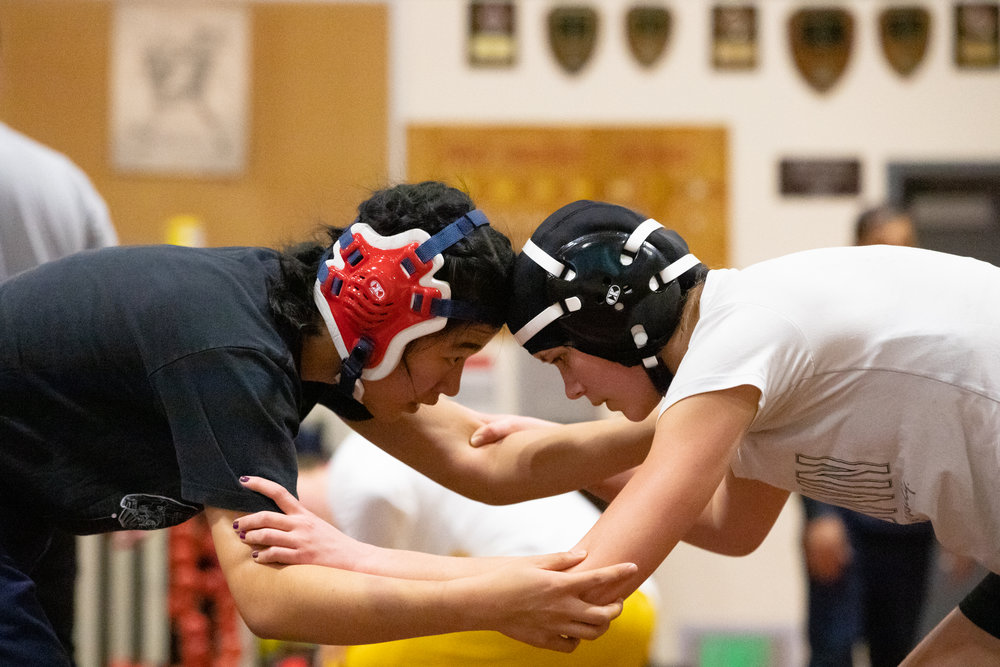 Paris Harrell wrestles Carolyn Ma, a Saratoga High School senior, during a practice for the CCS Championship at Cupertino High School in Cupertino, California, on Feb. 12. Wrestlers selected for CCS from Mountain View High School, Los Altos High School and Saratoga High School practiced with the Cupertino High School athletes.
