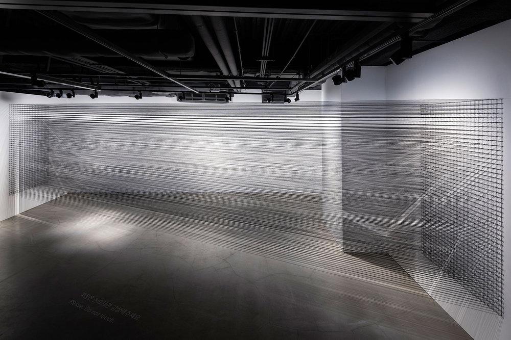 06.EunHyeKang_Flexible Tension_Cotton yarn_Site-specific installation_2018.jpg