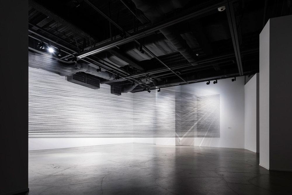 07.EunHyeKang_Flexible Tension_Cotton yarn_Site-specific installation_2018.jpg