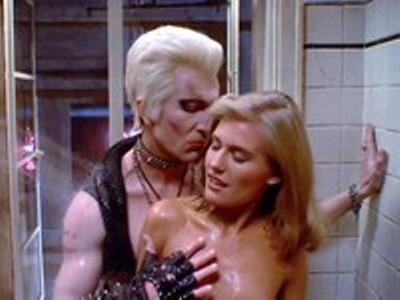 You can see Barbara Crampton's --who I think this is--breasts in the movie, but I've protected you from them. Because I am a hero. (picture from hotflick.net)