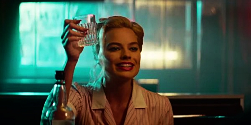 """Cheers! Enjoy these stories!"" says Margo Robbie. (cinemablend.com)"