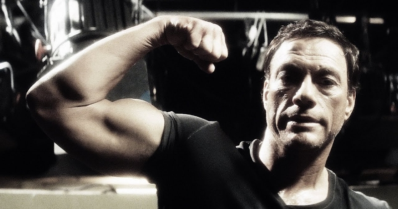Yes, Van Damme has gotten older. Also yes, his bicep is still quite massive, thank you. (streamondemandathome.com)