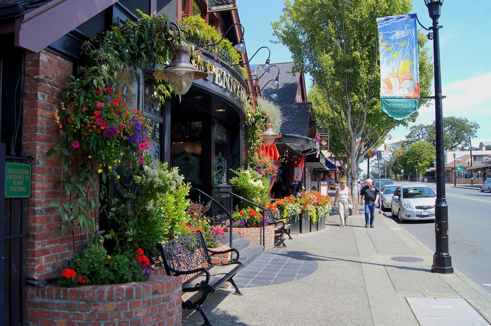 Oak Bay's Main Street is colourful all year round with flowers, banners and in the winter the trees are full of lights.
