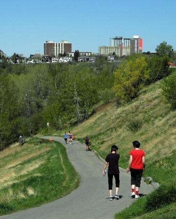 Typical pathway in Calgary being enjoyed by people of all ages and backgrounds. No Calgarian is more than a 5 minute walk from a park or the pathway system.