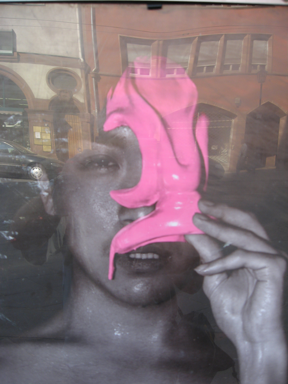 "Titled ""Mask"" this mixed-media work is a reflection of a poster in a window that creates an intriguing layer of images.  There is a theatrical quality to this artwork, as if we are all part of performance art piece."