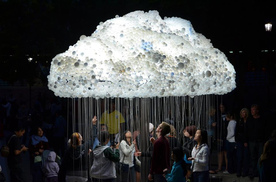 "The ""Cloud""  is an interactive art installation by artist Caitlind r.c. Brown that was unveiled at Nuit Blanche September 15th 2012 on Calgary's Olympic Plaza.  The artwork is made of 1000 working light bulbs with pull chains and 5000 burt- out light bulbs donated by public. Visitors independently pull the chains to turn the light bulbs on and off which result in a shimmering effect.  While I was there, the public all got together to turn off all the light bulbs and then at a count of 3 they pulled the chains all the lights came on at once.  You gotta like public art that is fun."