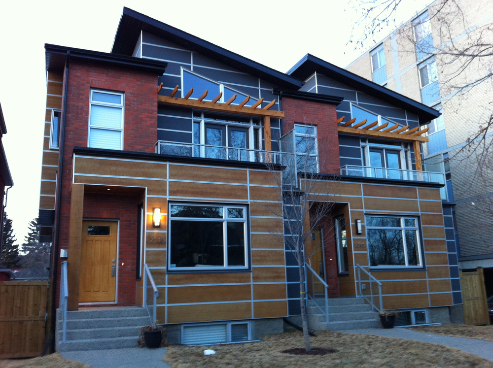 Another example of the infills that are on every block of our inner city communities.  In this case a modern duplex has been built where there once was a small cottage bungalow.