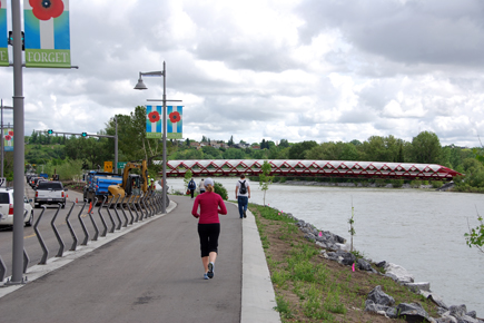 Another view of the Peace Bridge and how it links to the pathway on the north side of the Bow River.  It is all part of the Downtown Bow River pedestrian experience.  A second iconic pedestrian bridge is currently under construction at the east end of the Downtown to create a circular urban walking path.