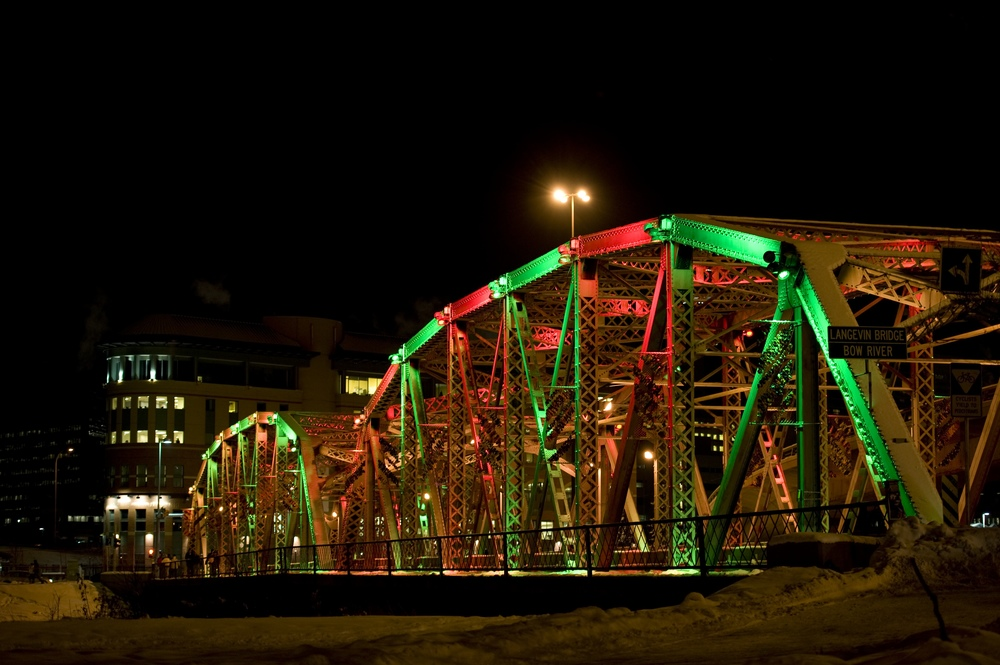 In 2009, Calgary Municipal Land Corporation, installed a state of the art LED lighting system on the 110 year old  Langevin Bridge which is the gateway into the downtown for many visitors to city from the airport.  The lights can be programmed in an infinite number of ways to celebrate various holidays and special events.  The total energy consumption per year is the equivalent of about 3 homes.  Photo credit: CMLC